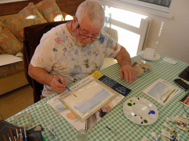 Artist Peter Hill demonstrating water colour techniques