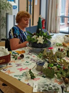 Joyce Designing Their Christmas Card Decoration at the Table