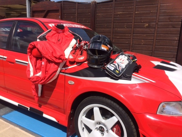 Chris Snell's safety equipment drapedovver his racing car